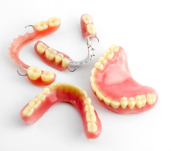 Sets of full and partial dentures at 80246 dentist office